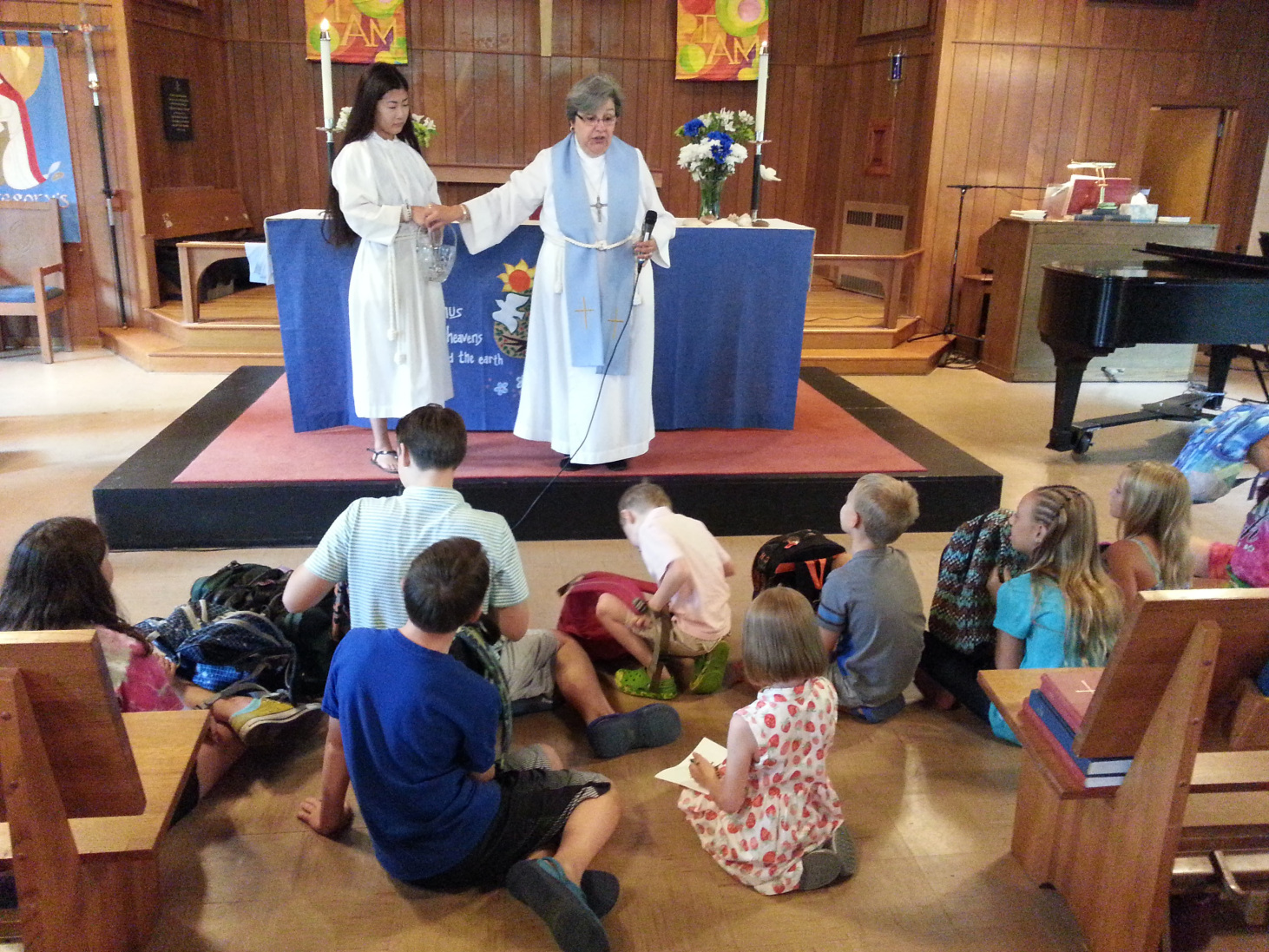 Rev. Susan talking to children